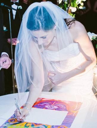 Jess signing Ketubah